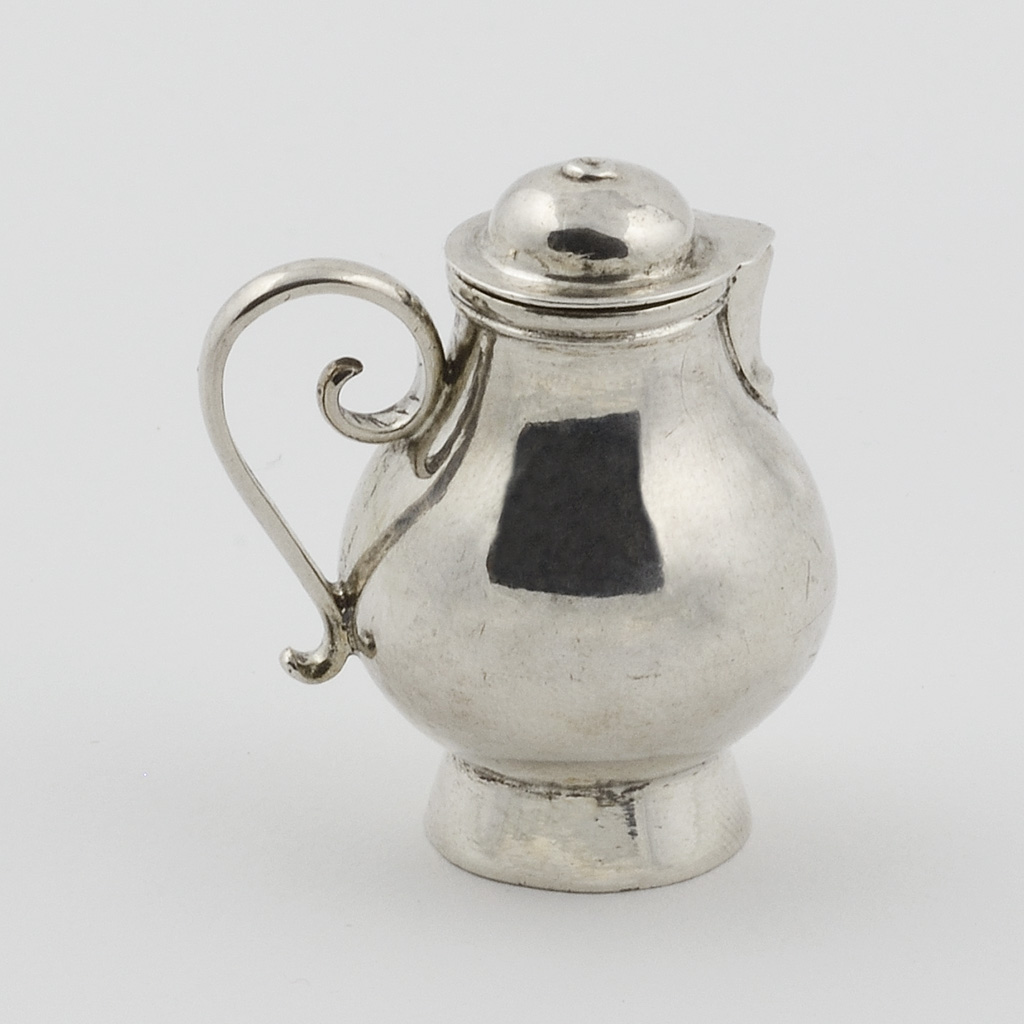 A George I Toy Silver Covered Jug.