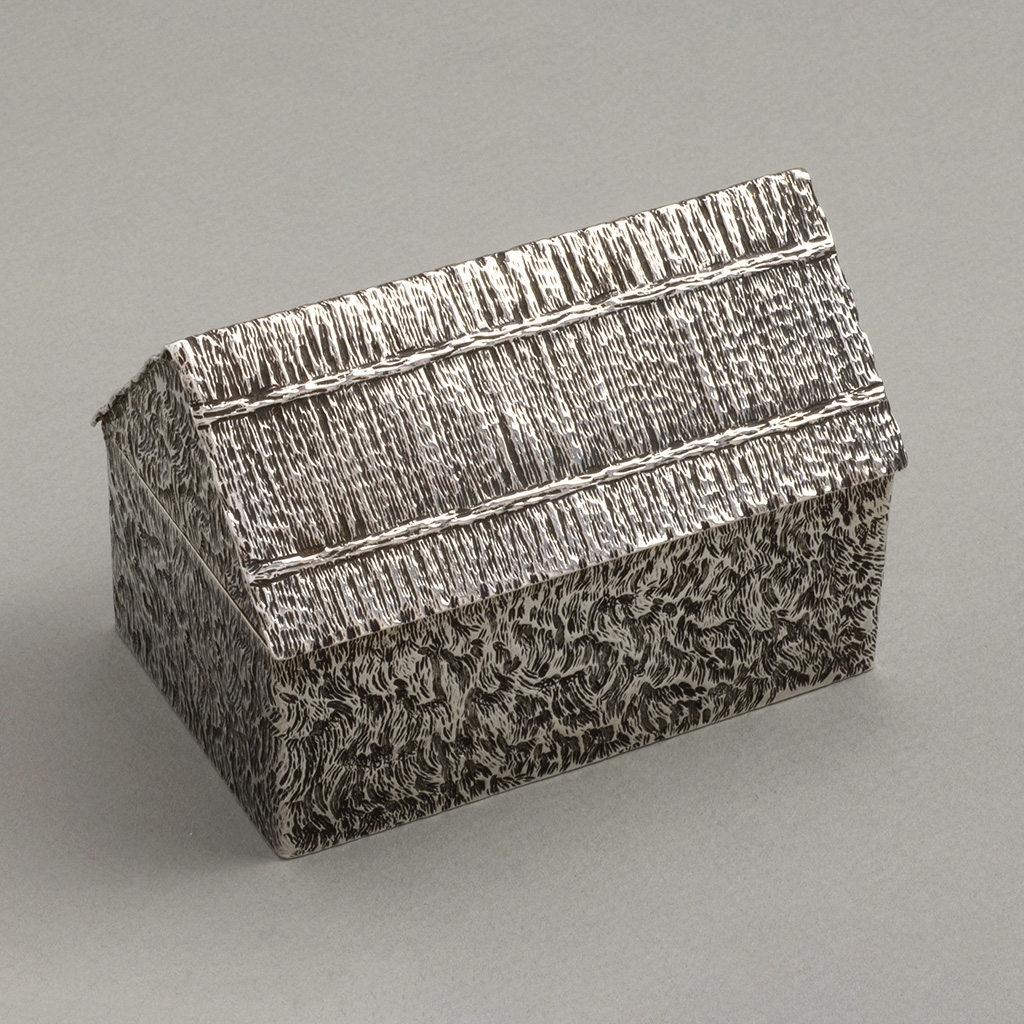 A Novelty Silver Cigarette Box And Matchbox In The Form Of A Haystack.