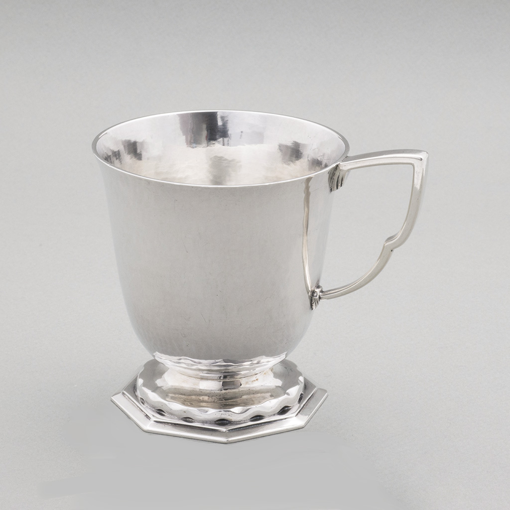 An Arts And Crafts Silver Mug.