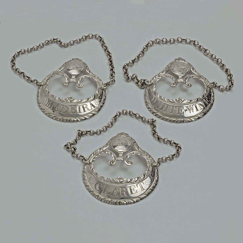 A Set Of Three George III Silver Wine Labels By Hester Bateman.