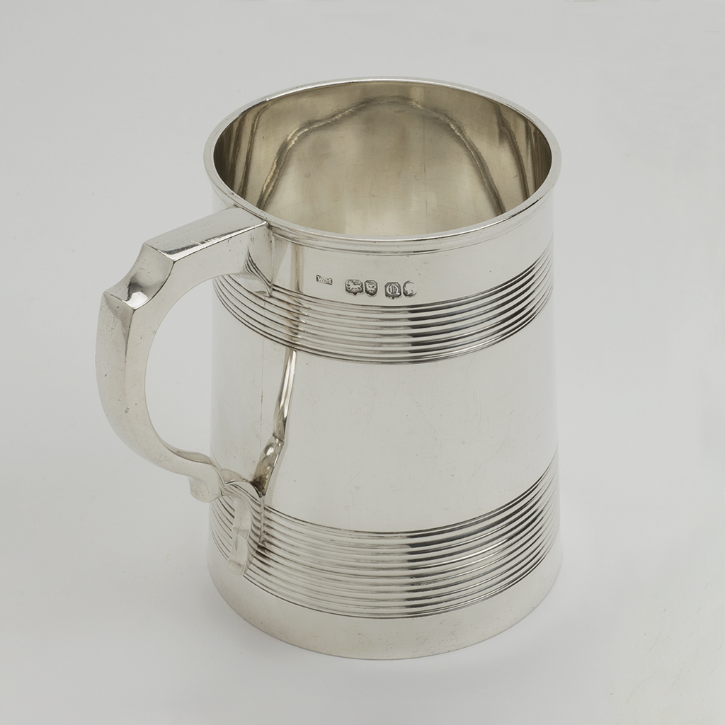 A Victorian Silver Large Reeded Mug.