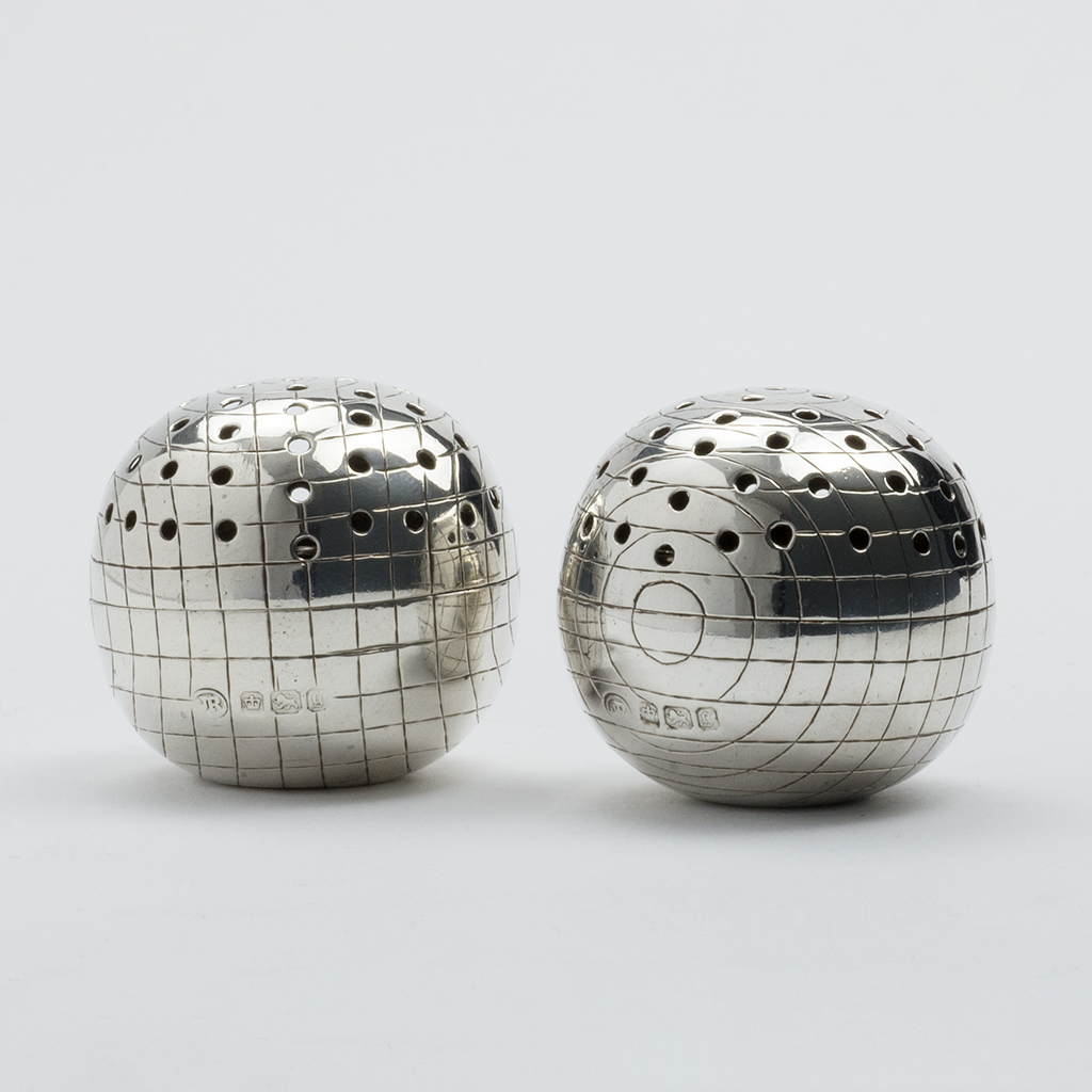 A Pair Of Late Victorian Silver Croquet Ball Pepper Pots.