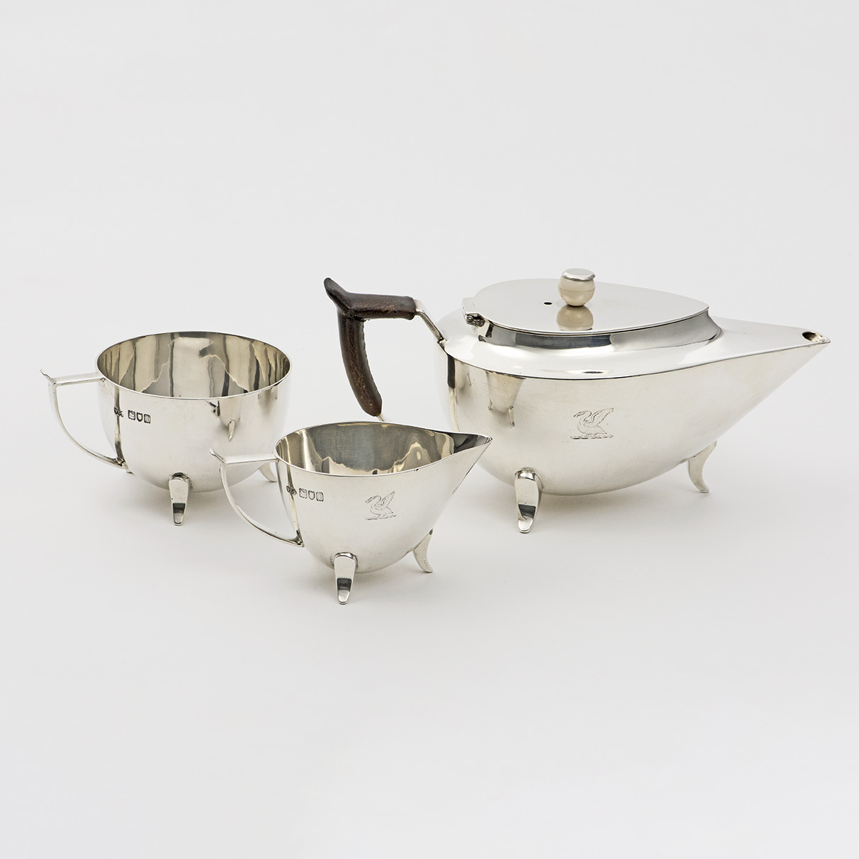 A 20th Century Silver Teaset Of Unusual Design.