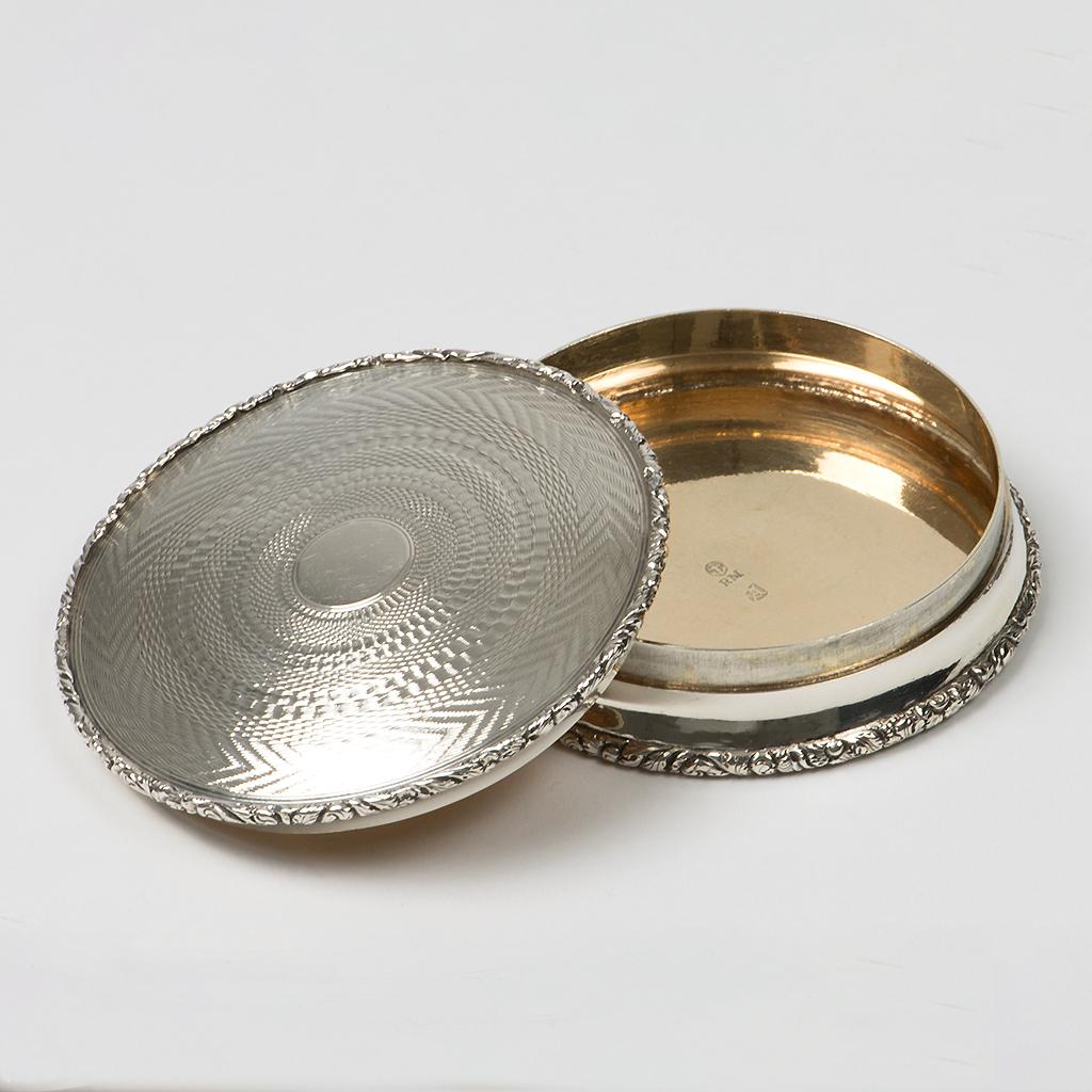 A Circular George IV Silver Snuffbox.