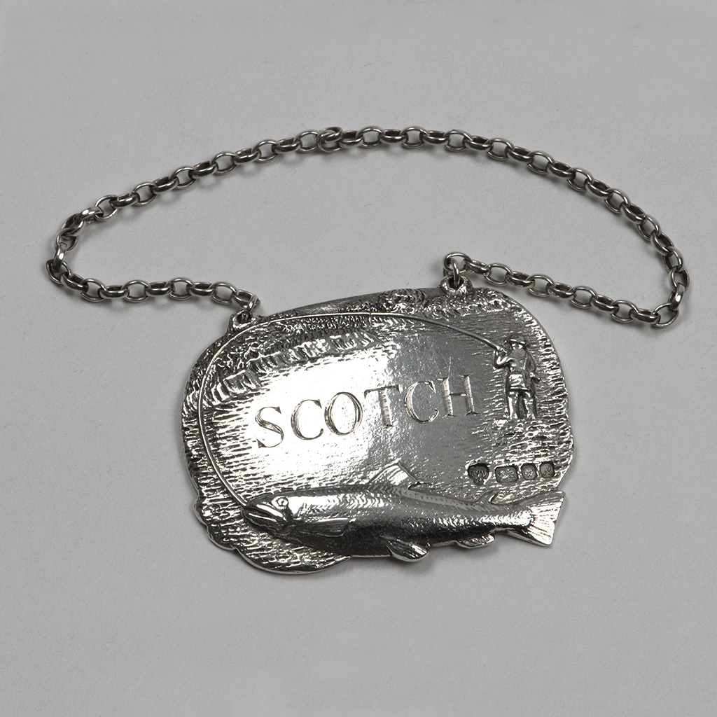 A Modern Silver Cast Wine Label For 'Scotch'.