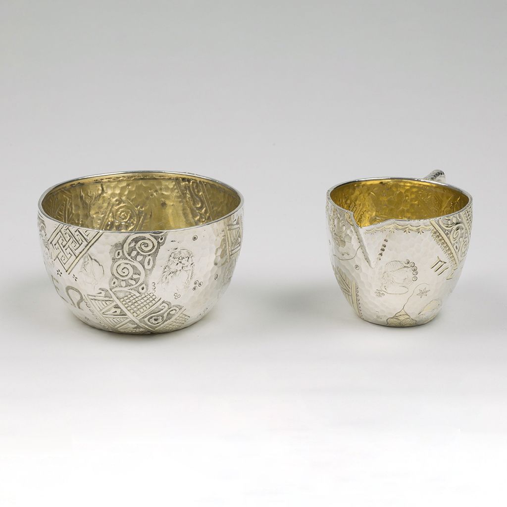 A Victorian Silver Bowl And Cream Jug In The 'Homeric' Style.