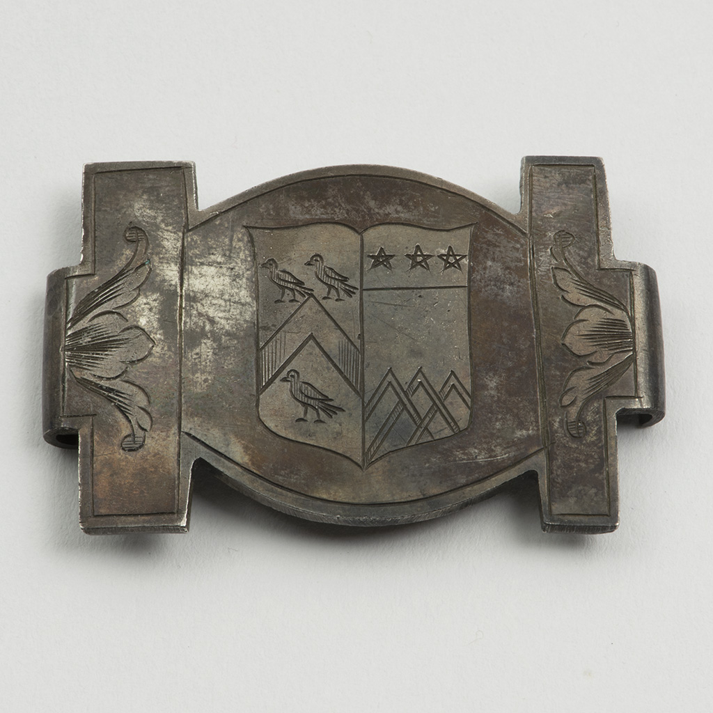 A 17th Century Silver Armorial Book Clasp.