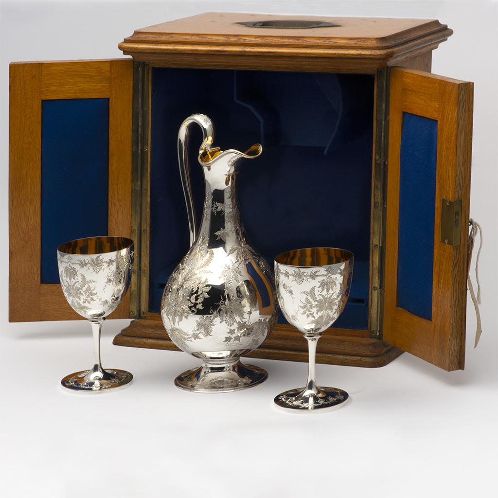 A Victorian Silver Claret Jug With Two Matching Wine Goblets.