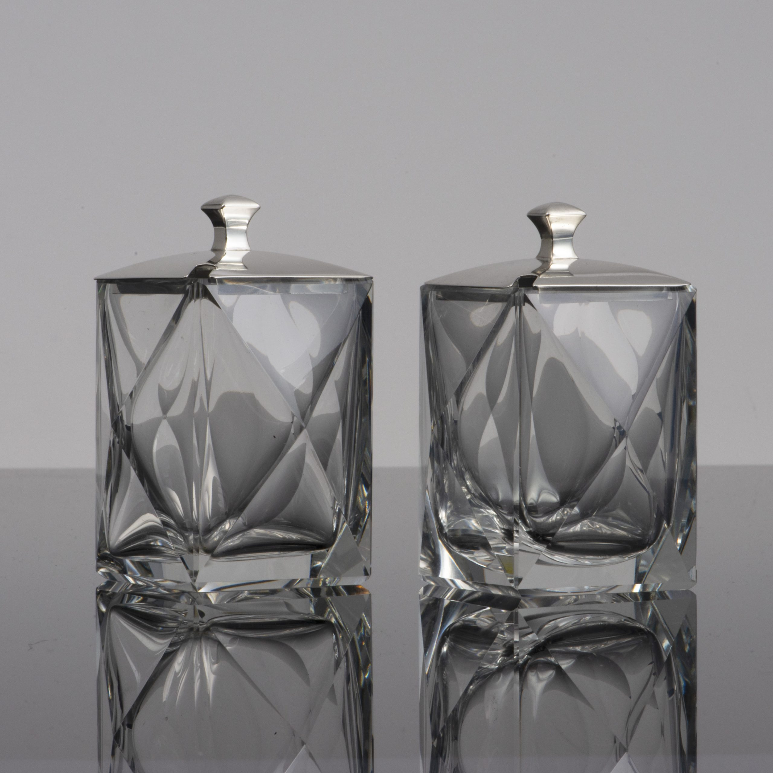 A Pair Of Silver Lidded Art Deco Glass Jars.