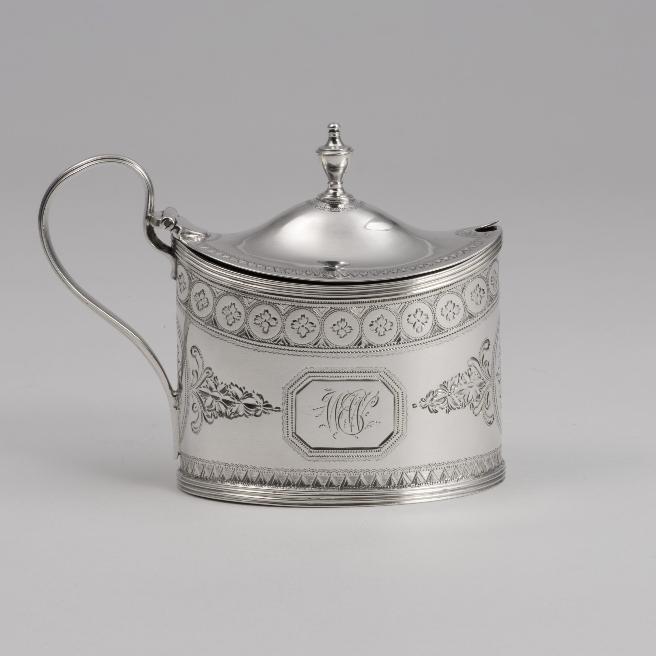 A George III Bright-cut Silver Mustard Pot.