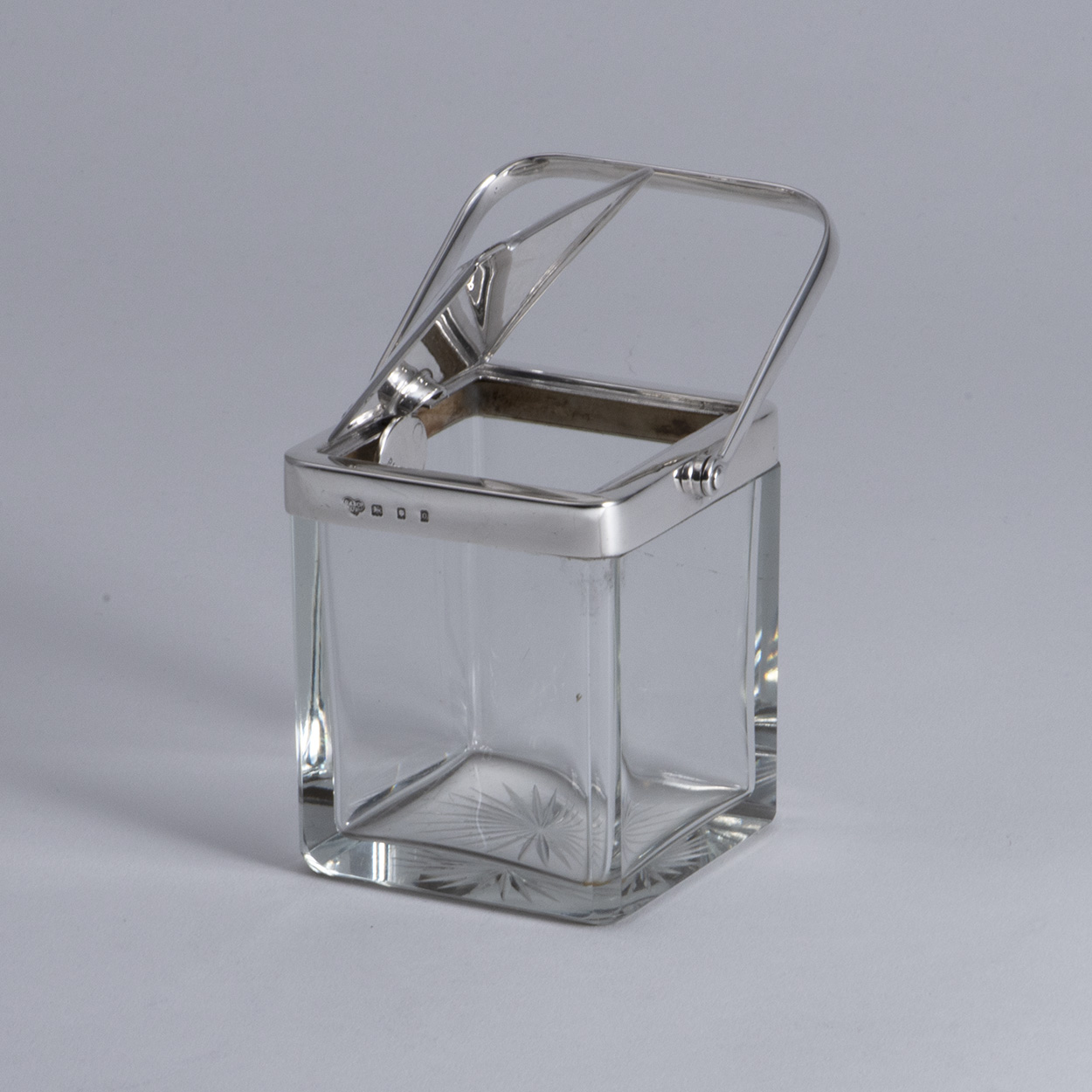 An Art Deco Silver-mounted Glass Patent Jam Pot.