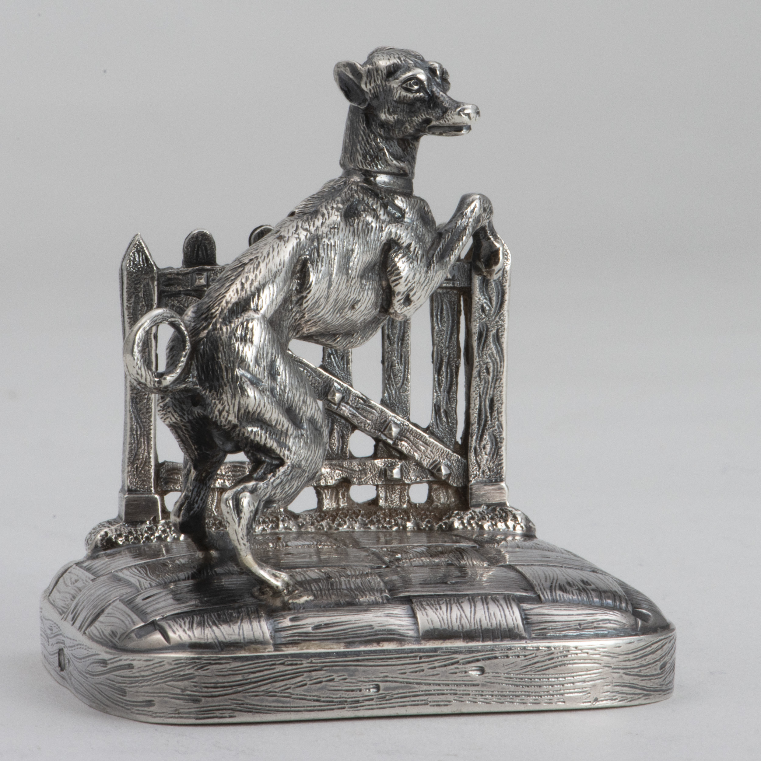 A French Silver Menu Holder In The Form Of A Whippet Dog Standing At A Gate.