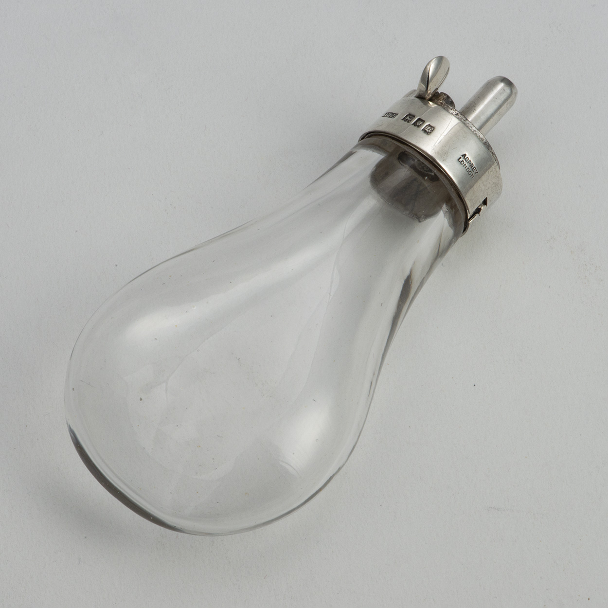 A Silver And Glass Novelty Powder Flask By Asprey And Company.